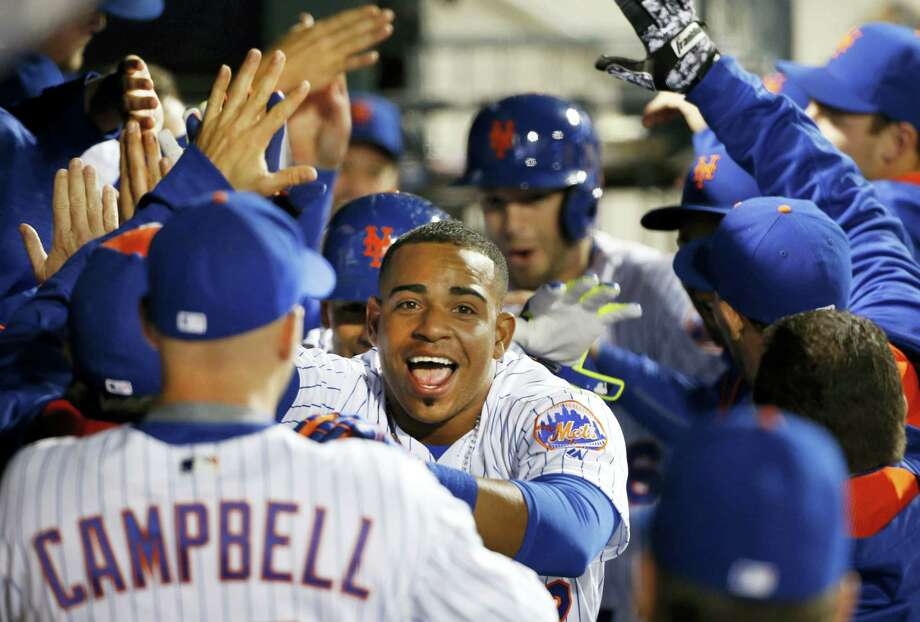 Yoenis Cespedes, center, celebrates with teammates after hitting a seventh-inning home run on Tuesday. Photo: Kathy Willens — The Associated Press  / Copyright 2016 The Associated Press. All rights reserved. This material may not be published, broadcast, rewritten or redistributed without permission.
