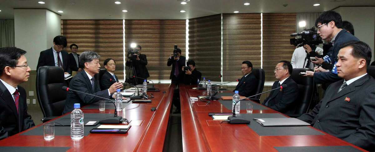 Hwang Boogi, second from left, South Korea's vice minister of unification and the head negotiator for high-level talks with North Korea, talks as his North Korean counterpart Jon Jong Su, second from right, listens during their meeting at the Kaesong Industrial Complex in Kaesong, North Korea, Friday, Dec. 11, 2015. North and South Korea on Friday held high-level talks at a North Korean border town, a small step meant to improve ties battered by a military standoff in August and decades of acrimony and bloodshed.