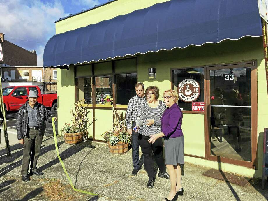 Ben Lambert - The Register Citizen  The Good Company Coffee House, located on Franklin Street in Torrington, officially opened for business Wednesday. Above, owner Michelle Wall, center, and Mayor Elinor Carbone, right, cut the ribbon during the grand opening. Photo: Digital First Media