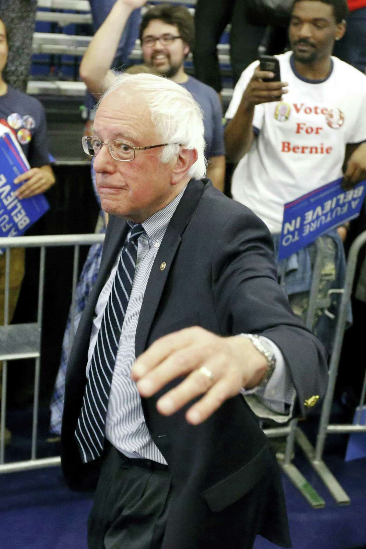 Democratic presidential candidate Sen. Bernie Sanders, I-Vt., waves as he leves a campaign rally at Fitzgerald Fieldhouse on the University of Pittsburgh campus, Monday, April 25, 2016, in Pittsburgh.