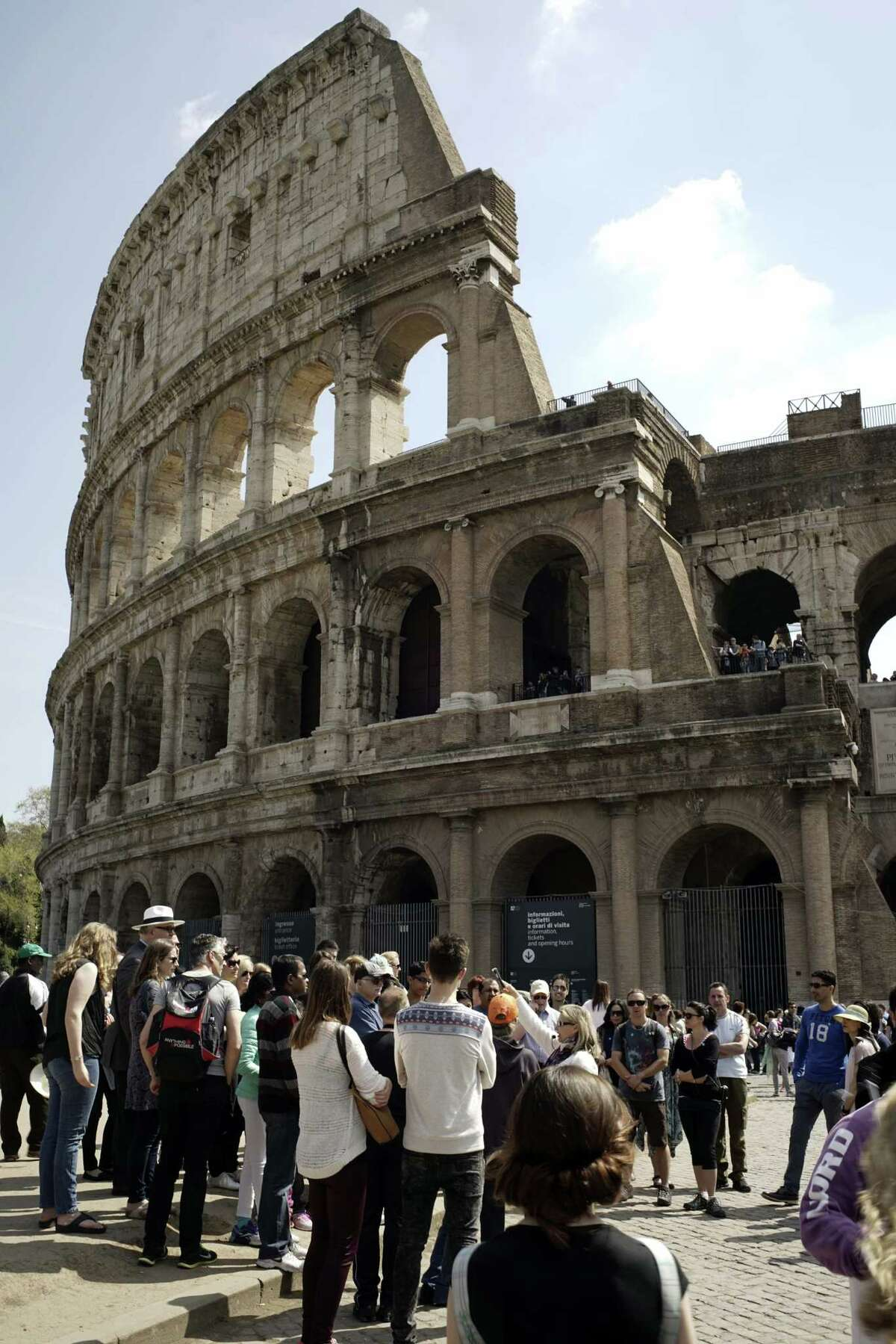 In this photo taken on Friday, April 10, 2015, people line up to enter the Colosseum, in Rome. Vacations in Europe have a new attraction: the euro's steep drop in value is making the continent much cheaper for tourists from across the world, especially the United States and China. For American tourists, the dollarís strength translates into a discount of around 25 percent compared with this time last year. Chinaís currency has risen some 20 percent against the euro over the past year. (AP Photo/Andrew Medichini)