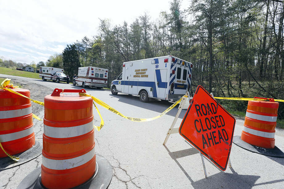 Law enforcement has closed down Union Hill Road in Pike County, Ohio, while they investigate a shooting with multiple fatalities on Friday, April 22, 2016.  Authorities say multiple people have been shot to death in rural Ohio, some 80 miles east of Cincinnati. Emergency vehicles are stationed on Union Hill Road in Pike County near the scene of a multiple homicide investigation. Photo: Chris Russell/The Columbus Dispatch Via AP   / The Columbus Dispatch