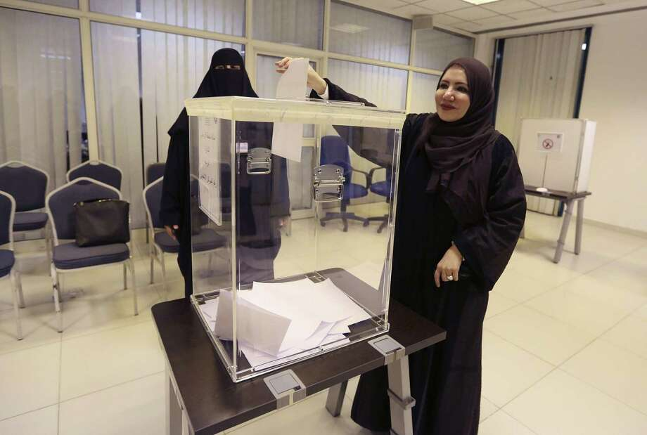 Saudi women vote at a polling center during the country's municipal elections Saturday in Riyadh, Saudi Arabia. Photo: Associated Press  / AP
