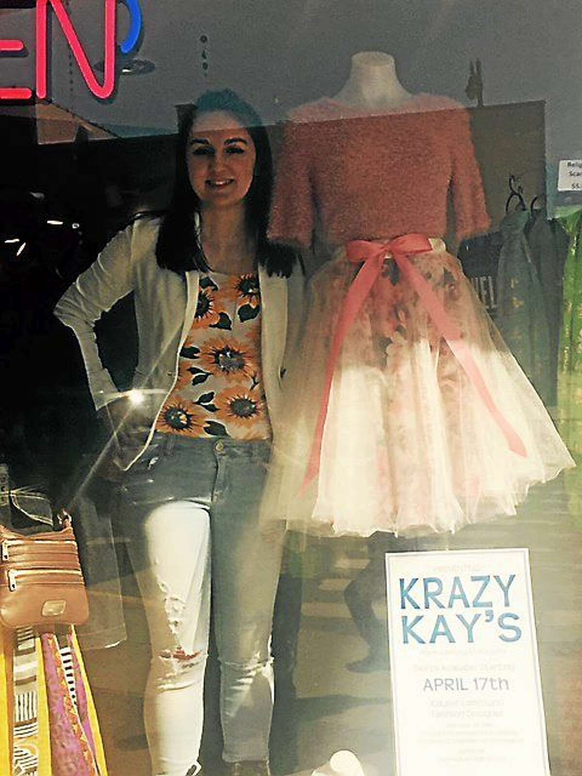 Kaylee Lanczycki, of Krazy Kay's, with one of her tulle skirts in the window of Joey's Fashions on Main Street.