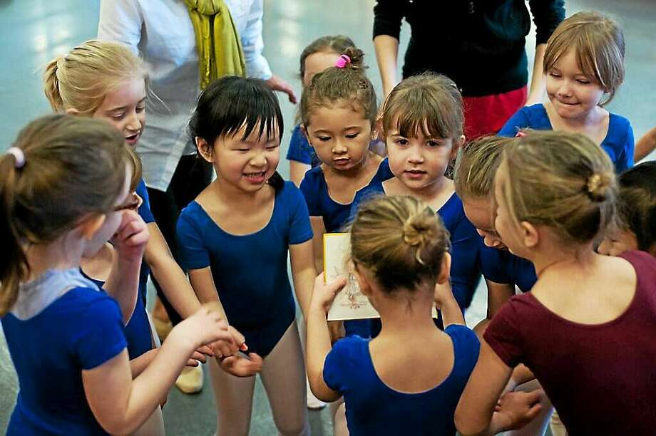 Image by Don Perdue  Young ballet students get acquainted during a recent event. Photo: Journal Register Co.