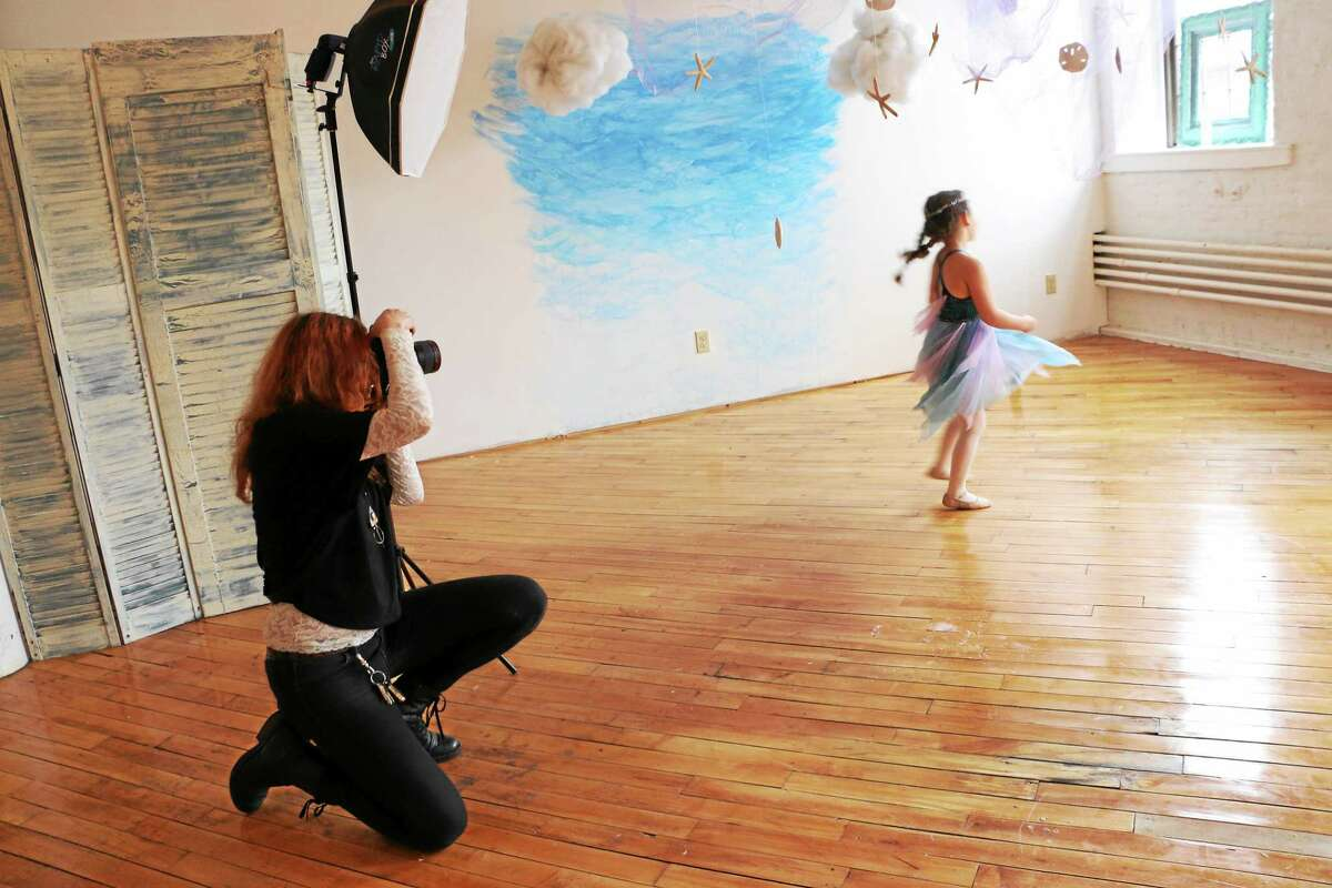 Corey Lynn Tucker takes photos of River at her studio at the Hurley Business Park.