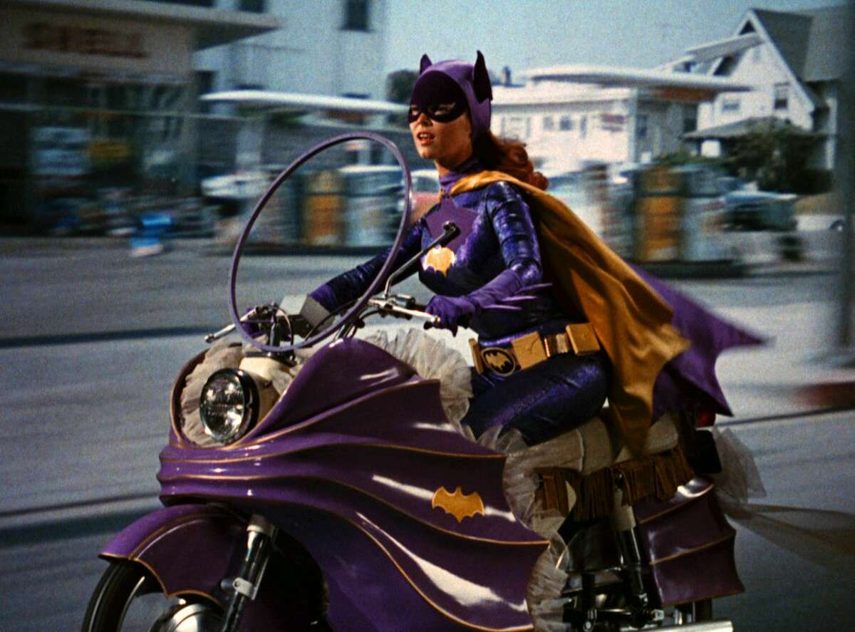 """In this image released by Warner Bros. Entertainment, Yvonne Craig portrays the crime-fighting Batgirl in the 1960s TV hit """"Batman."""" Craig died Monday, Aug. 17, 2015 in her Los Angeles home from complications from breast cancer. She was 78."""