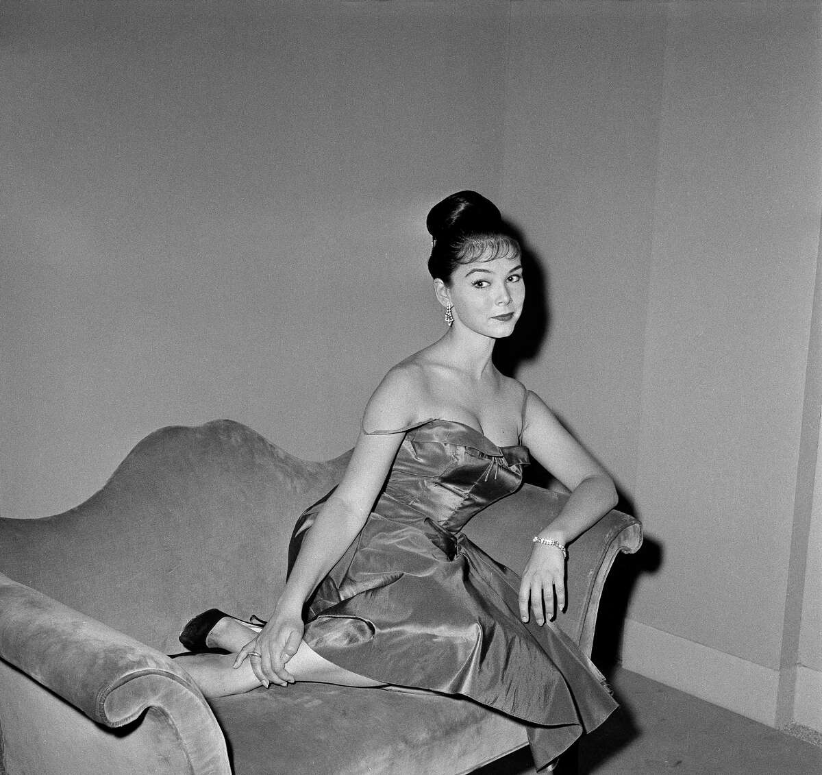 """In this July 11, 1959, file photo, actress Yvonne Craig poses on the set of """"The Gene Krupa Story,"""" in Los Angeles. Craig, who played the sexy, crime-fighting Batgirl in the 1960s TV hit """"Batman,"""" died Monday, Aug. 17, 2015. She was 78. Craig died in her Los Angeles home from complications from breast cancer."""
