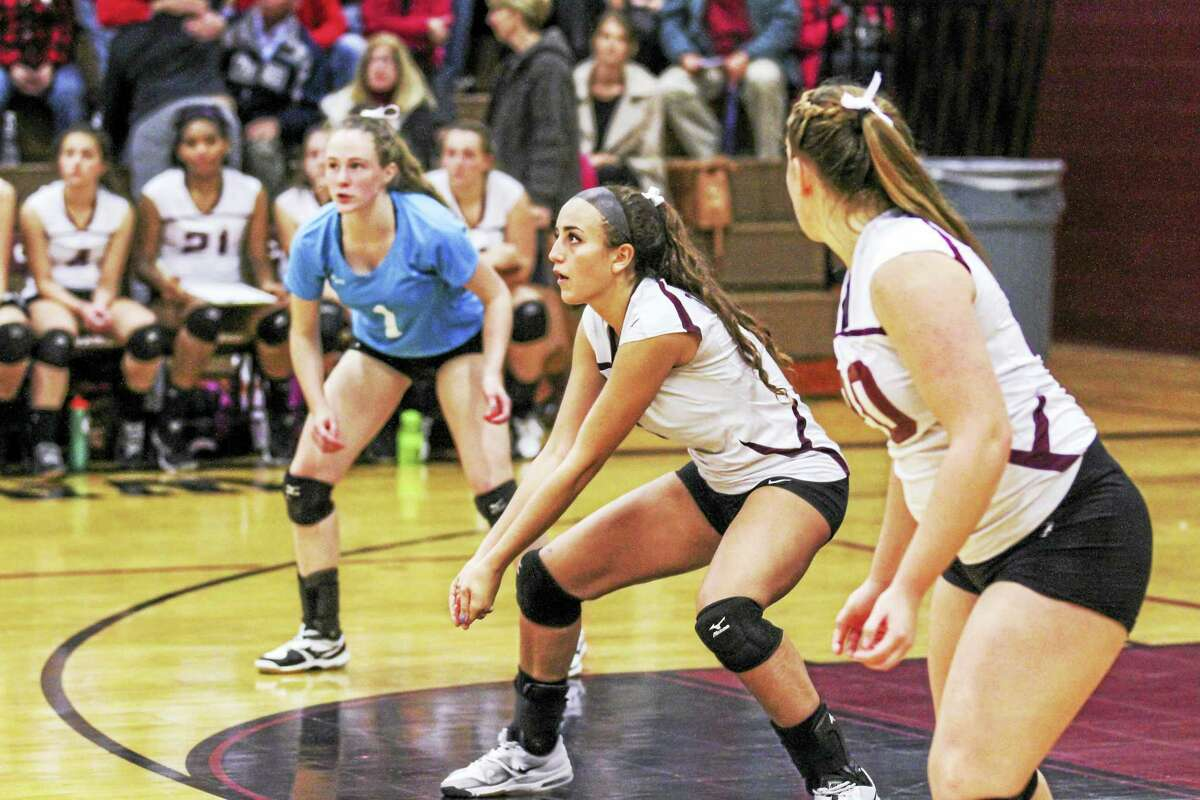 Carissa Carbone (center), one of Torrington's smallest players, packed one of its biggestd punches at the net in the Red Raiders' Class M semifinal win over Northwestern Tuesday evening.