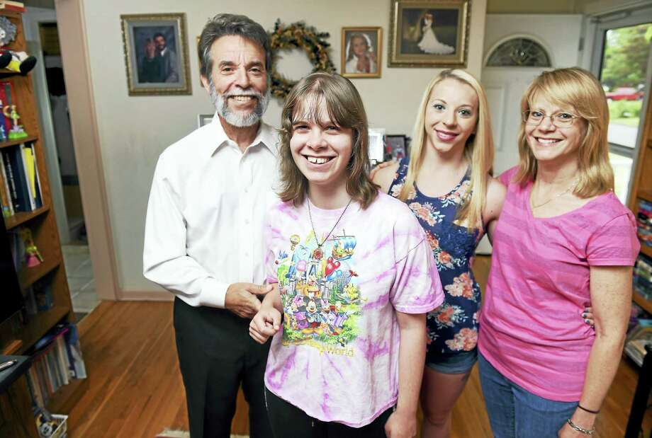 Jessie Zangrillo, center, is photographed with her father, Richard Zangrillo, left, twin sister, Christine Zangrillo, right, and mother, Michelle Rivelli, far right, at their home in West Haven. Photo: Arnold Gold — New Haven Register