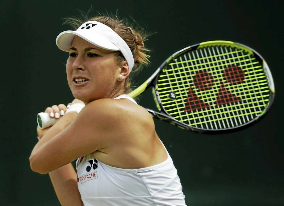 Belinda Bencic returns to Bethanie Mattek-Sands on July 3 at the All England Lawn Tennis Championships in Wimbledon, London. Photo: Alastair Grant — The Associated Press File Photo  / AP