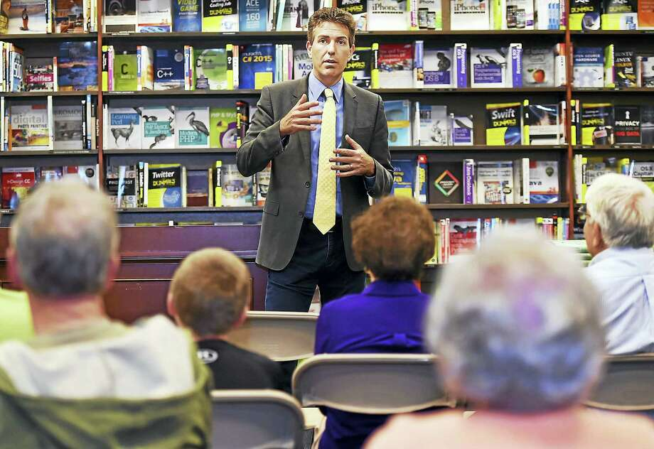 """Wayne Pacelle, president and CEO of the Humane Society of the United States, discusses his new book, """"Humane Economy: How Innovators and Englightened Consumers are Transforming the Lives of Animals,"""" Saturday at the Yale Bookstore in New Haven. Photo: Catherine Avalone — New Haven Register    / New Haven RegisterThe Middletown Press"""