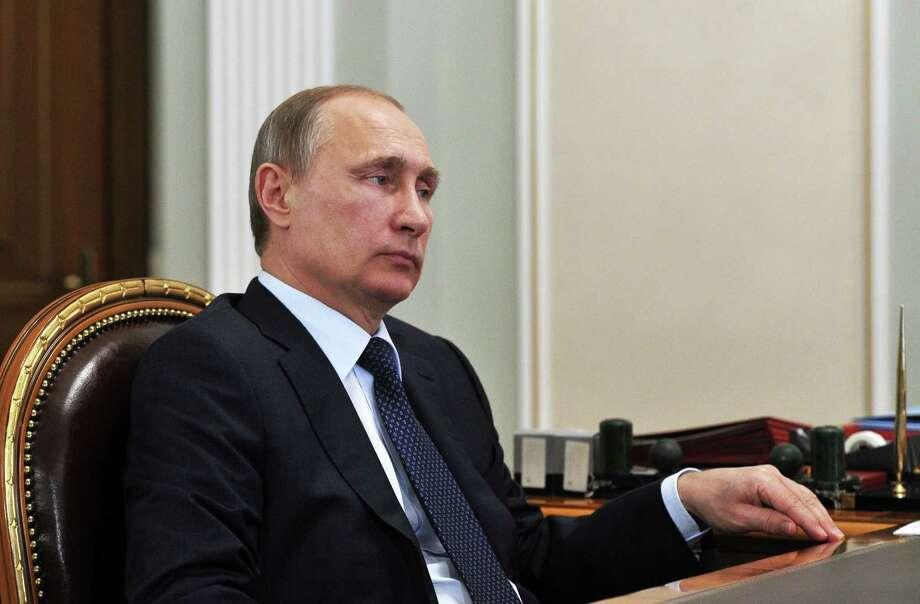 Russian President Vladimir Putin listens during a meeting in the Novo Ogaryovo residence, outside Moscow on April 13, 2015. Photo: Mikhail Klimentyev/Pool Photo Via AP  / POOL RIA Novosti Kremlin
