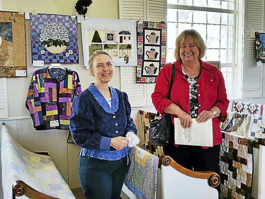 Organizer MaryPat Leger of the Sew Grateful quilting group talks to customer Arleen Pomaski of Barkhamsted at the ninth annual Quilt and Needle Arts Show in Wichester Center on Sunday. Photo: Photo By N.F. Ambery