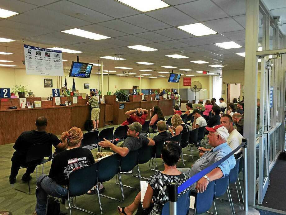 Lines were long Tuesday at the Winsted DMV office, which re-opened alongside others statewide after a computer upgrade. Photo: Ben Lambert — The Register Citizen