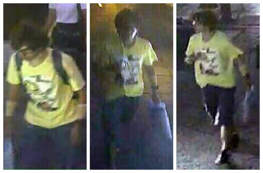 This Aug. 17, 2015, image, released by Royal Thai Police spokesman Lt. Gen. Prawut Thavornsiri shows a man wearing a yellow T-shirt near the Erawan Shrine before an explosion occurred in Bangkok, Thailand. Prawut said he believes the man is a suspect in the blast that killed a number of people at a shrine in downtown Bangkok on Monday night. Photo: Royal Thai Police Via AP / Royal Thai Police