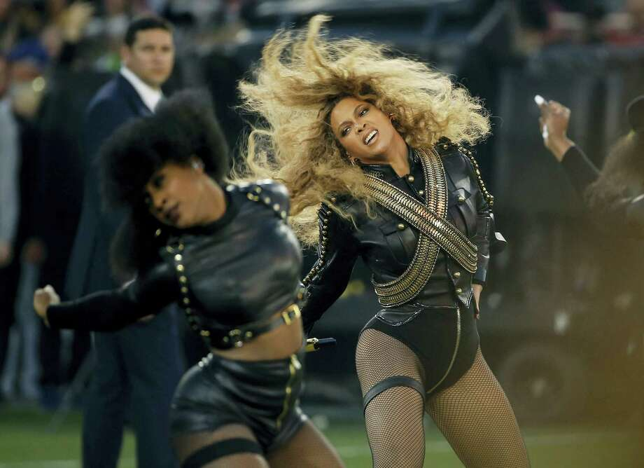 """In this Feb. 7, 2016,photo, Beyonce performs during halftime of the NFL Super Bowl 50 football game in Santa Clara, Calif. Beyonce dropped more than an album with """"Lemonade,"""" on April 23, 2016 —  her dazzling new musical and visual project that speaks to the deeply personal and political. Photo: AP Photo/Matt Slocum, File  / AP"""
