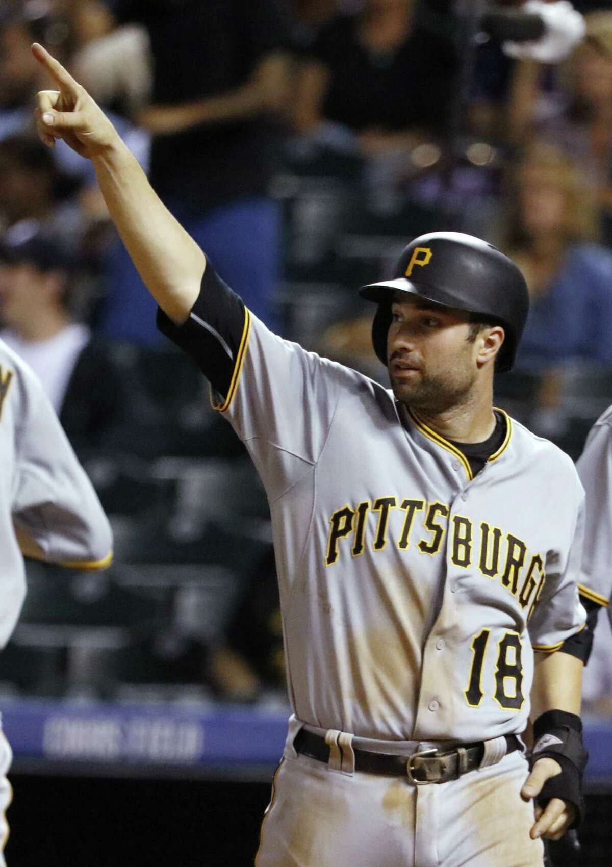 FILE - This Sept. 23, 2015 file photo shows Pittsburgh Pirates' Neil Walker gesturing to Sean Rodriguez after Rodriguez hit a three-run double against the Colorado Rockies during the ninth inning of a baseball game in Denver. The New York Mets have acquired Neil Walker from the Pittsburgh Pirates for left-hander Jonathon Niese. The teams agreed to the swap of established big leaguers Wednesday, Dec. 9, 2015, at the winter meetings. (AP Photo/Jack Dempsey, file)