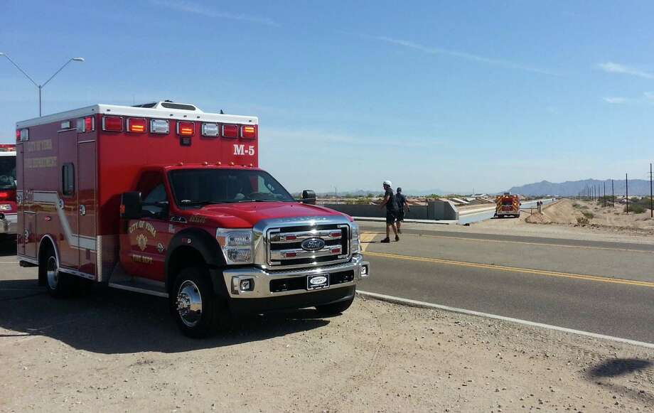 In this photo provided by Yuma Fire Department, authorities work a perimeter near a canal in Yuma, Ariz., Saturday, April 11, 2015. Twin 18-month-old boys were pronounced dead at a hospital after being pulled from the Arizona canal, police said Saturday. Photo: (AP Photo/Yuma Fire Department Via Public Affairs For Yuma County, Kevin Tunell) / Public Affairs for Yuma County via Kevin Tunell