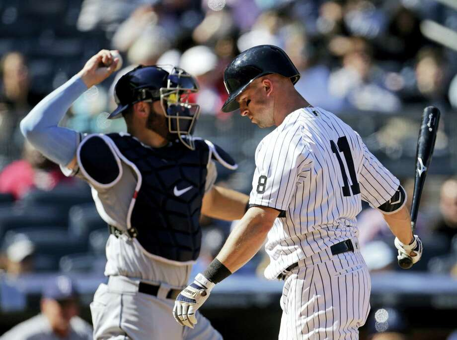 The Yankees Brett Gardner (11) reacts after striking out during the eighth inning on Sunday. Photo: Adam Hunger — The Associated Press  / FR110666 AP