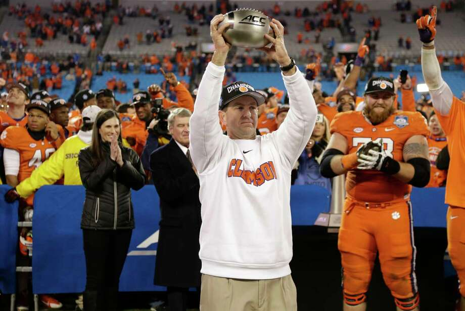 Clemson head coach Dabo Swinney celebrates after defeating North Carolina 45-37 in the ACC championship game on Saturday in Charlotte, N.C. Photo: Bob Leverone — The Associated Press  / FR170480 AP