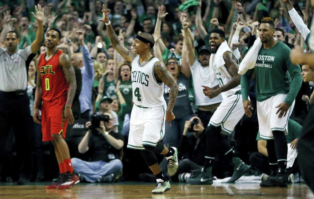 The Celtics' Isaiah Thomas (4) celebrates after hitting a 3-pointer during the fourth quarter against the Hawks on Sunday.