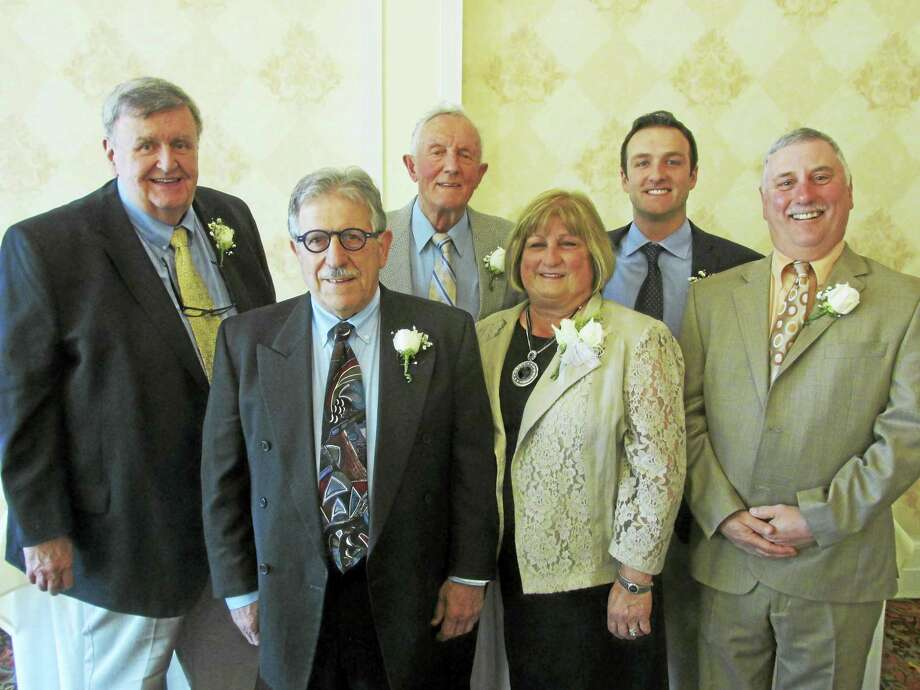 Class members present at the Torrington Athletic Hall of Fame's 20th induction ceremony Sunday evening were, front row, left to right, Joe Rinaldi, Pat Fairchild; back row, left to right, Mike Conway, Gino Fabiaschi, Mike Fabiaschi and R.J. Poniatoski. Photo: Photo By Peter Wallace