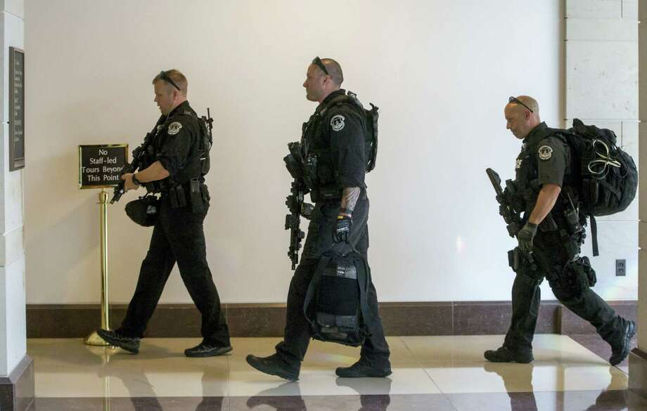 Capitol Police return to their stations as an emergency lockdown was lifted on Capitol Hill in Washington on Friday. Photo: AP Photo — J. Scott Applewhite / AP