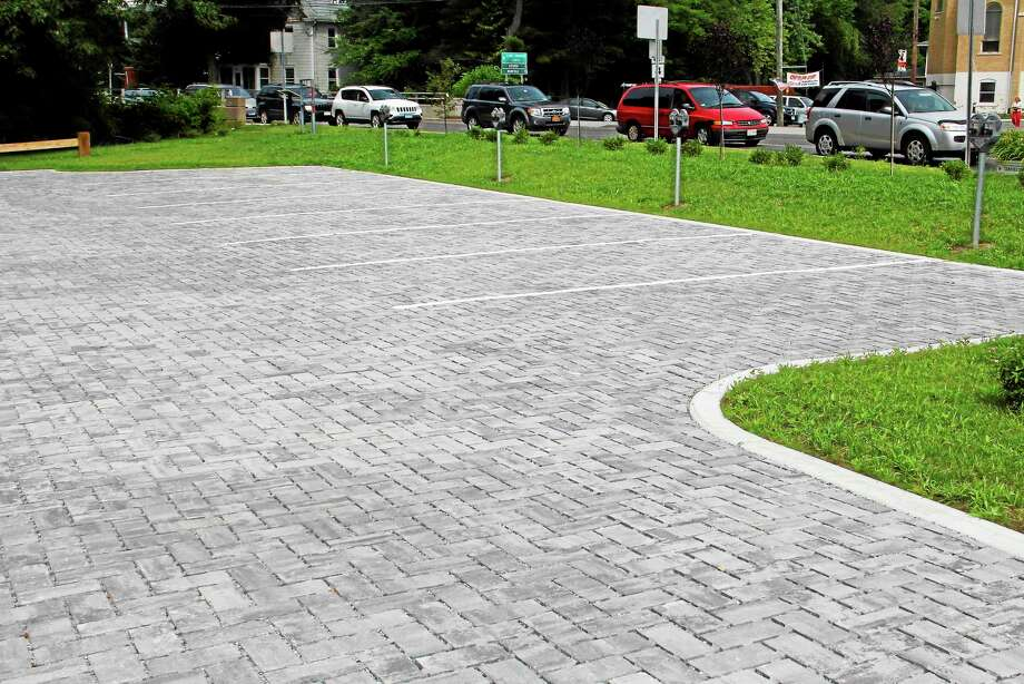The city's new municipal parking lot on the corner of Main Street and North Elm Street in Torrington is seen in this 2014 file photo. The parking lot has a low-impact design that helps gather rainwater and snow for the nearby Naugatuck River without debris. Photo: Register Citizen File Photo