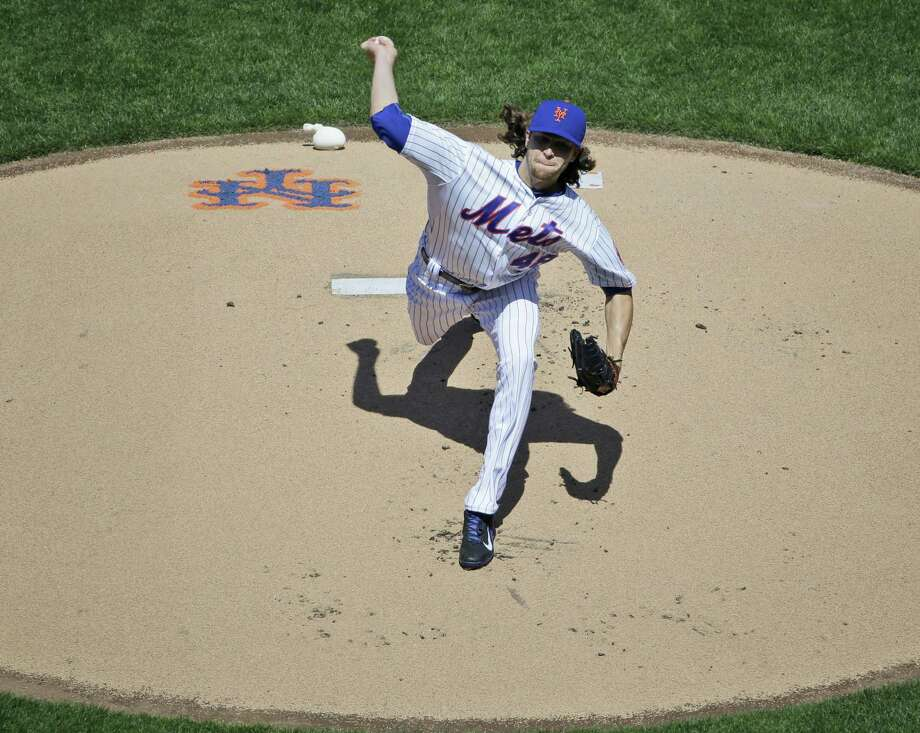 Mets starting pitcher Jacob deGrom delivers a pitch during the first inning Monday in New York. Photo: Seth Wenig — The Associated Press  / AP