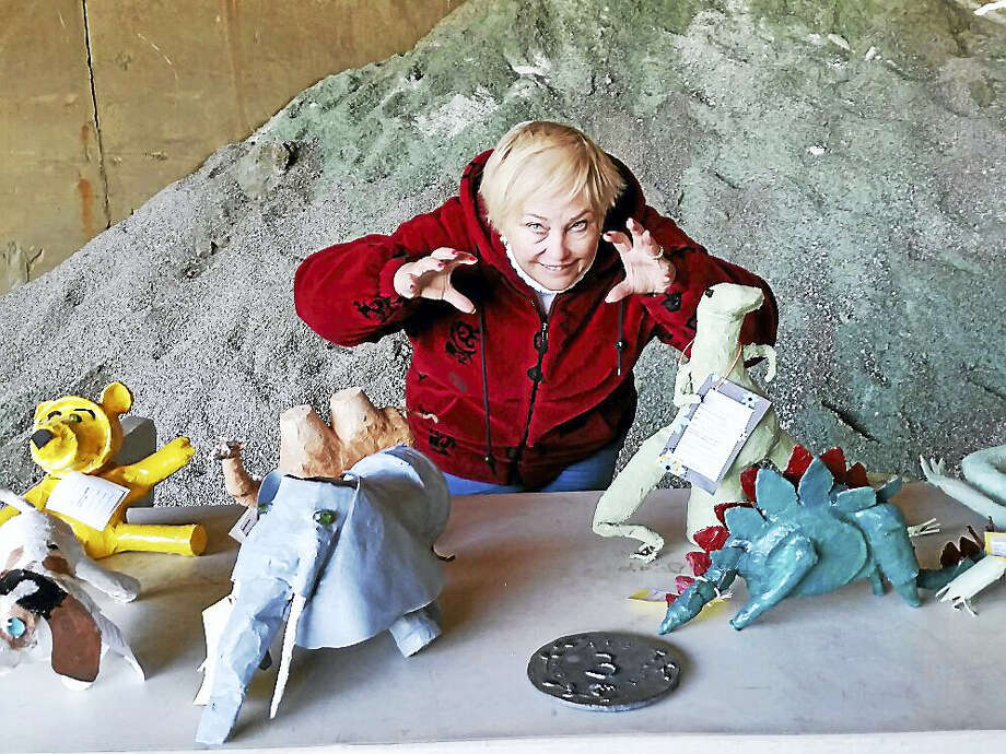 "N.F. Ambery photo Event organizer Gail Jacobson of Cornwall posed with second-place winner Marilyn Olsen's ""Art-a-Saur"" sculptures at the 14th annual Art @ the Dump at the Cornwall Transfer Station's sand shed building. Photo: Journal Register Co."