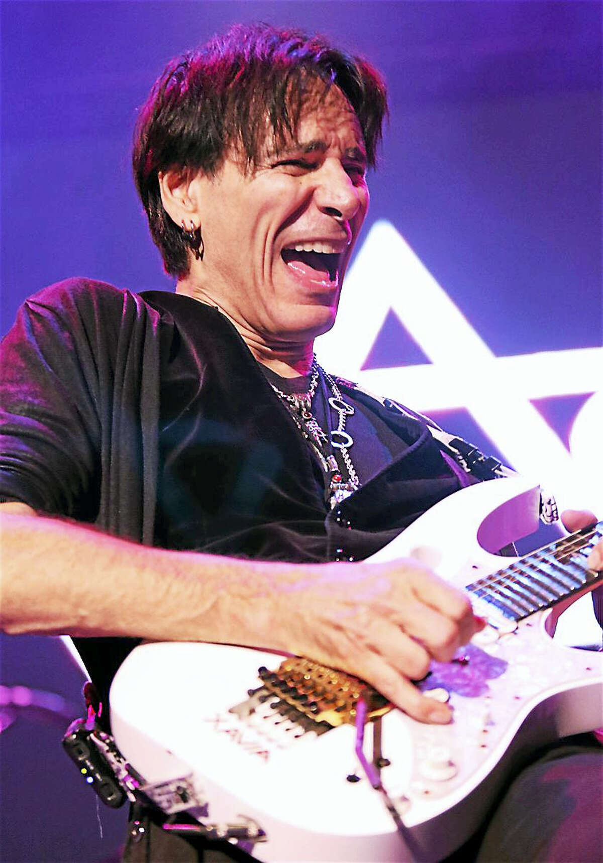 """Guitarist, singer, songwriter and producer Steve Vai is shown performing on stage to a sold-out crowd of fans at the Ridgefield Playhouse in Ridgefield on Nov. 7. He was voted the 10th """"Greatest Guitarist"""" by Guitar World magazine, and has sold over 15 million records during his nearly 40 years of making music. To learn more about this extraordinary guitarist, visit www.vai.com"""
