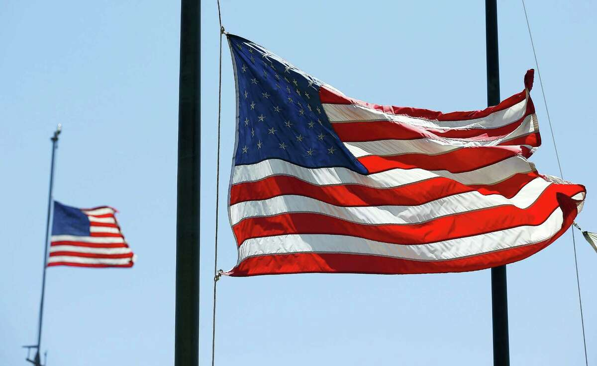 Flags fly at half-staff.