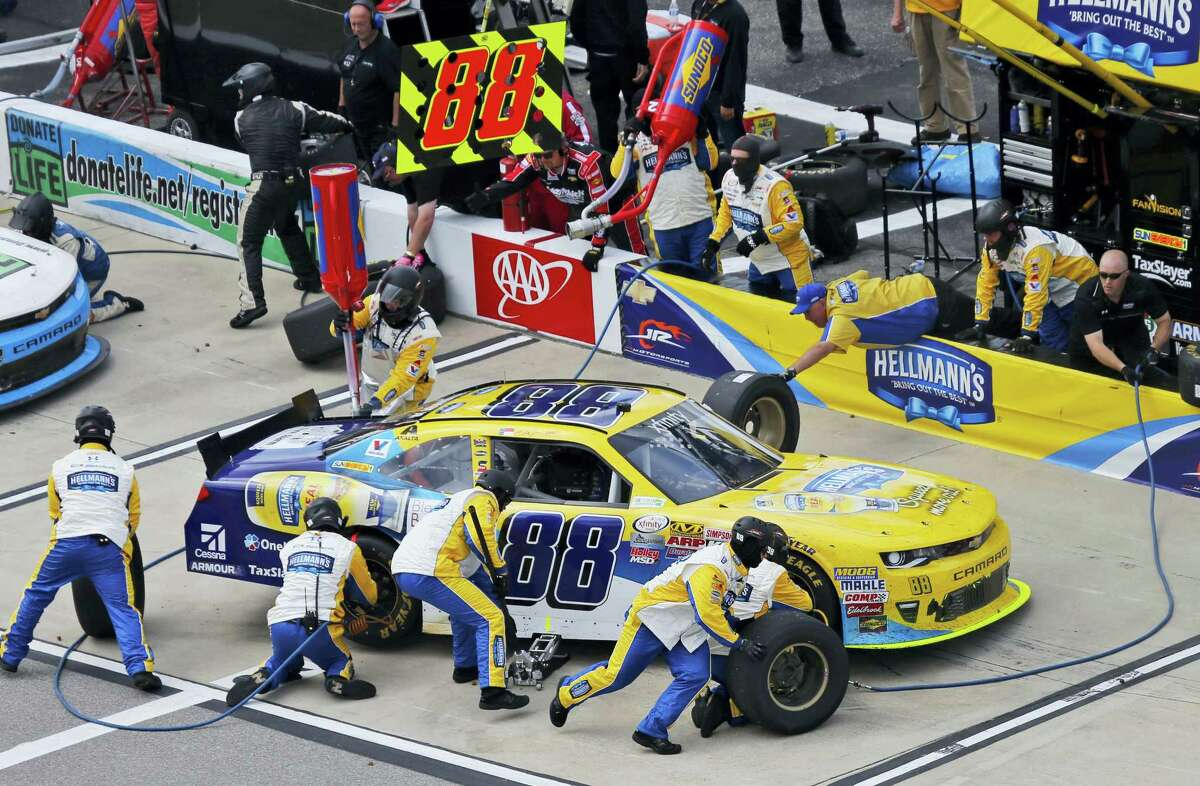 Dale Earnhardt Jr. gets serviced in the pits during the Xfinity series race at Richmond International Raceway on Saturday.
