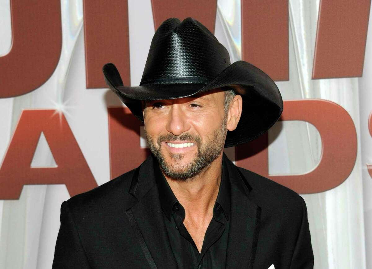FILE - In this Nov. 9, 2011 file photo, country singer Tim McGraw arrives at the 45th Annual CMA Awards in Nashville, Tenn.