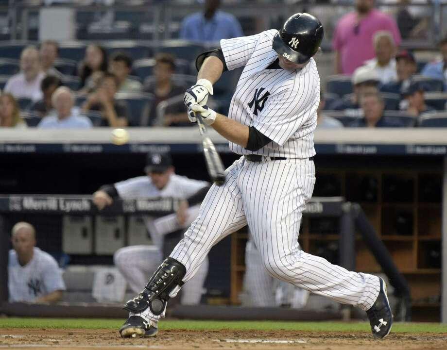 The Yankees' Brian McCann hits a three-run home run in the first inning against the Twins on Monday at Yankee Stadium. Photo: Bill Kostroun — The Associated Press  / FR51951 AP