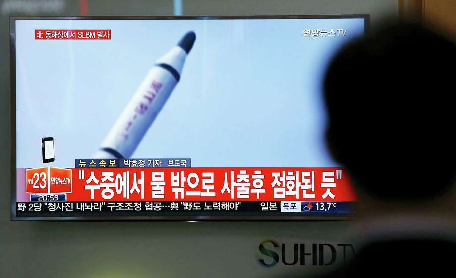 """A man watches a TV news program showing file footage of a missile launch conducted by North Korea, at the Seoul Train Station in Seoul, South Korea, Saturday, April 23, 2016. North Korea on Saturday fired what appeared to be a ballistic missile from a submarine off its northeast coast, South Korean defense officials said, Pyongyang's latest effort to expand its military might in the face of pressure by its neighbors and Washington. The Korean letters at top left read: """"North Korea fires a submarine-launched ballistic missile or SLBM."""" Photo: AP Photo/Lee Jin-man   / Copyright 2016 The Associated Press. All rights reserved. This material may not be published, broadcast, rewritten or redistributed without permission."""