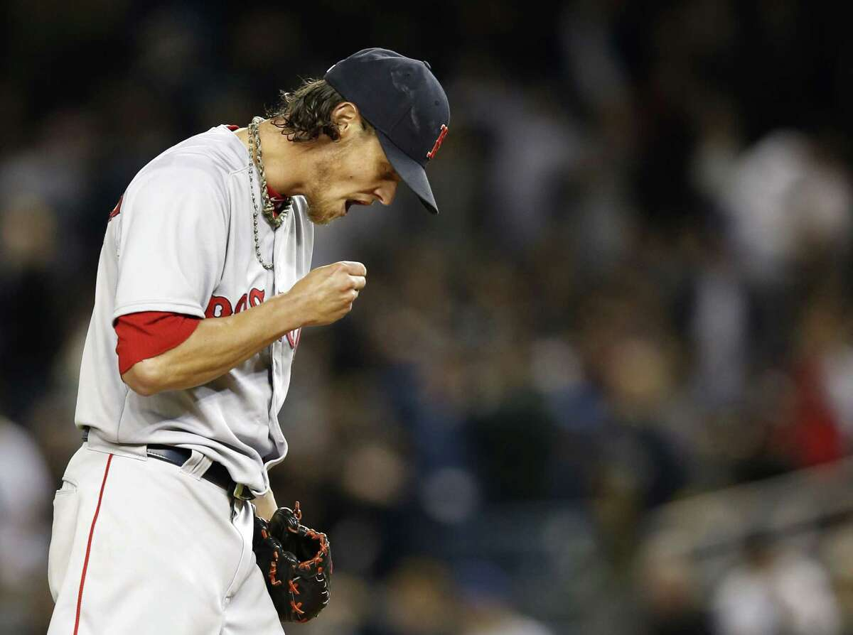 Red Sox starting pitcher Clay Buchholz reacts during the first inning of Sunday's game against the Yankees.