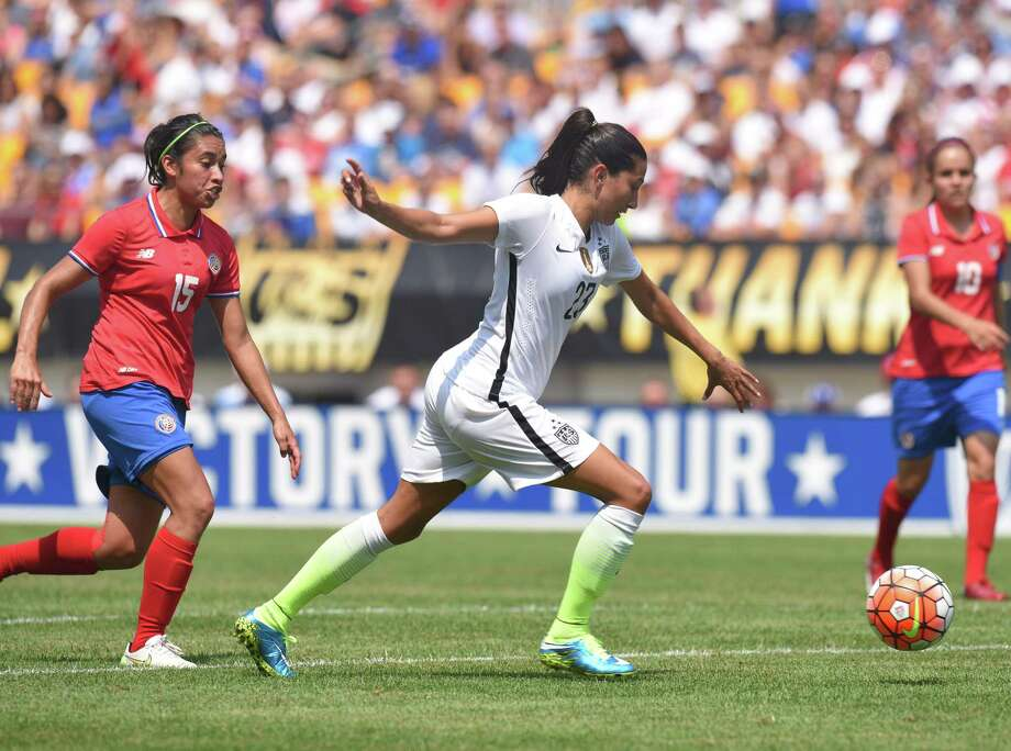 United States forward Christen Press beats Costa Rica midfielder Cristin Granados to score a goal during the first half of a women's friendly Sunday in Pittsburgh. Photo: Don Wright — The Associated Press  / FR87040 AP