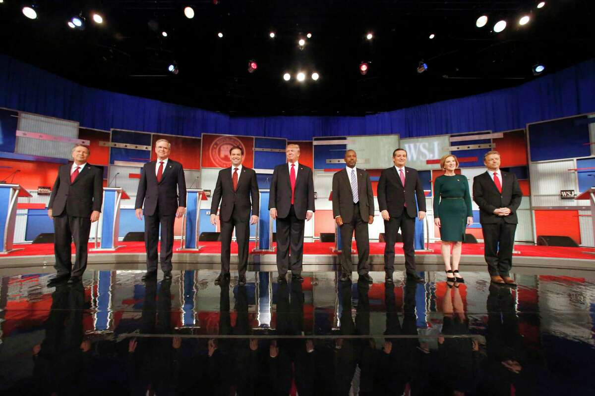 In this Tuesday, Nov. 10, 2015, file photo, Republican presidential candidates John Kasich, Jeb Bush, Marco Rubio, Donald Trump, Ben Carson, Ted Cruz, Carly Fiorina and Rand Paul take the stage before the Republican presidential debate at the Milwaukee Theatre in Milwaukee. The U.S. presidential election was one of the hottest topics on Facebook in 2015.