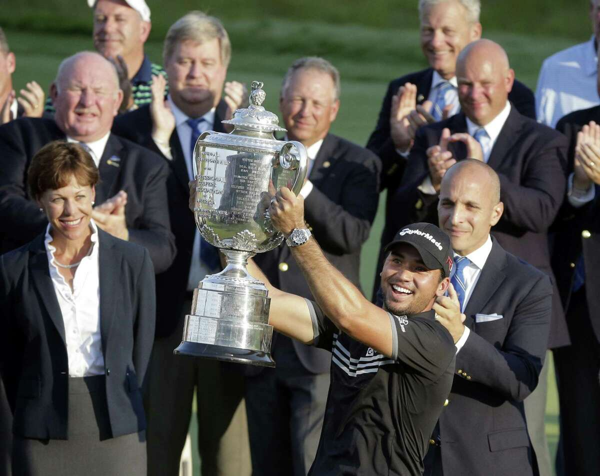 Jason Day smiles as he holds up the Wanamaker Trophy after winning the PGA Championship Sunday at Whistling Straits in Haven, Wis.