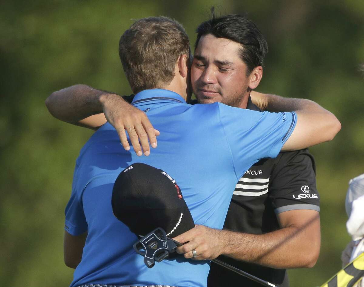 Jason Day, right, hugs Jordan Spieth after winning the PGA Championship Sunday at Whistling Straits in Haven, Wis.