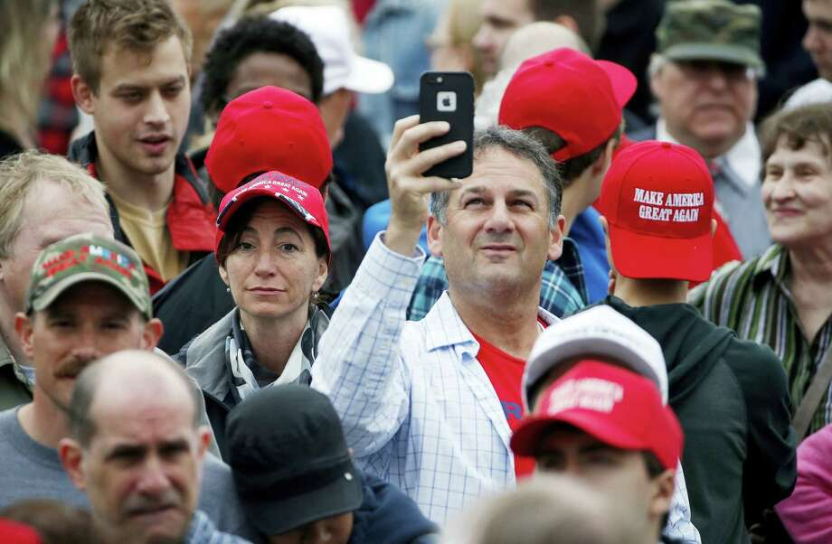 Linda Nichio, center left, of Bridgeport, Conn., and Nick D'Amico, center right, of Westbrook, Conn., wait in line prior to a rally for Republican presidential candidate Donald Trump in Bridgeport, Saturday, April 23, 2016. Photo: AP Photo/Michael Dwyer   / Copyright 2016 The Associated Press. All rights reserved. This material may not be published, broadcast, rewritten or redistributed without permission.