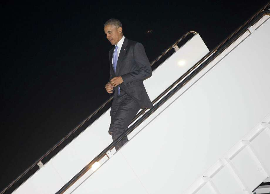 President Barack Obama walks down the stairs during his arrival on Air Force One at Andrews Air Force Base on April 11, 2015. Photo: AP Photo/Pablo Martinez Monsivais  / AP