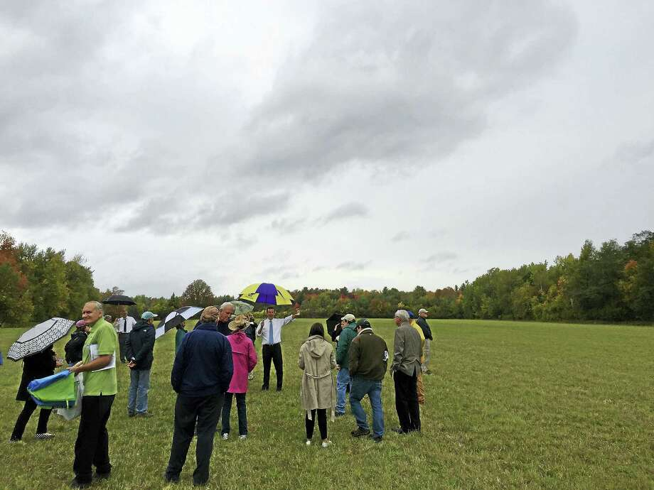 U.S. Sen. Chris Murphy, representatives of local land trusts and area residents visited the TorWin Farm property in Winsted in October. Photo: Ben Lambert — The Register Citizen