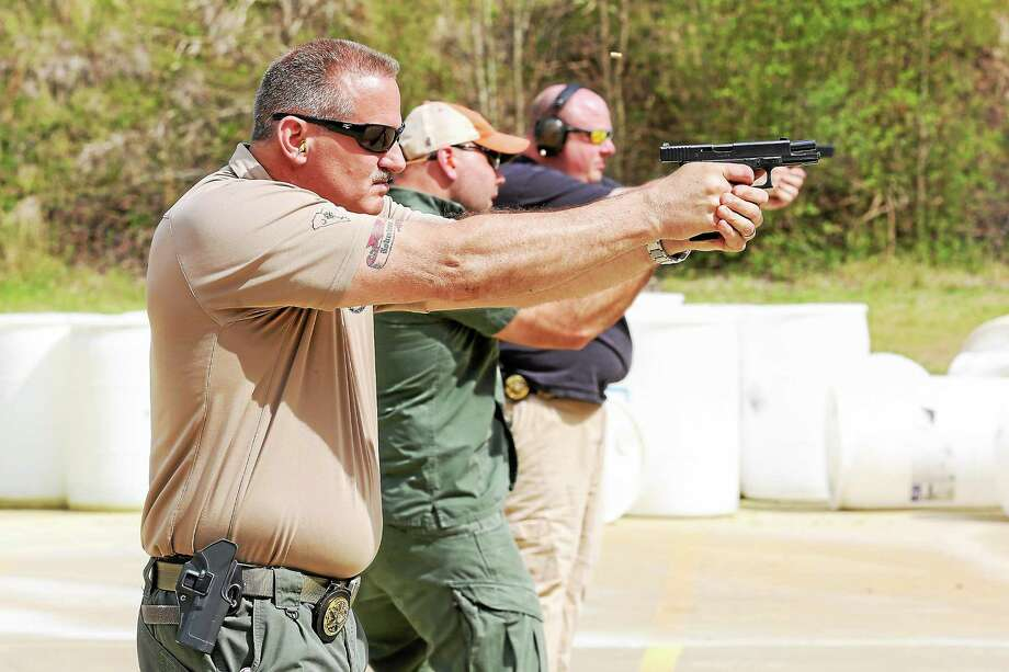Darlington County Deputy Sheriff and firearms instructor, Tim Robertson, trains law enforcement officers at the Florence Police Department firing range in Florence, S.C. on Thursday, April 2. In 2006, a jury found Robertson not guilty of murder in the shooting death of a suspect. Photo: For The Washington Post/Alice Keeney  / The Washington Post