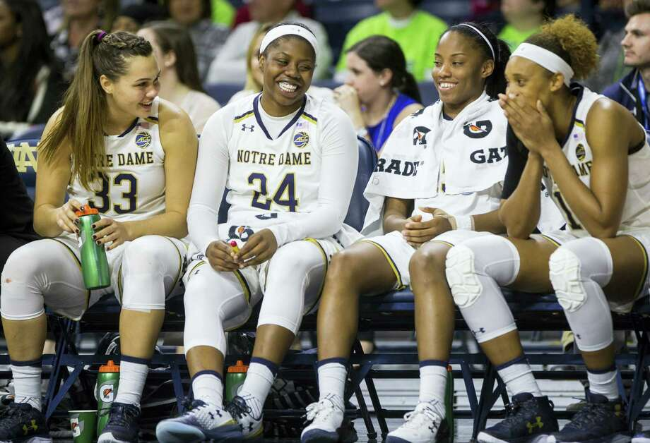 Notre Dame's Kathryn Westbeld (33), Arike Ogunbowale (24), Lindsay Allen, second from right, and Brianna Turner, right, joke around on the bench during the second half of an NCAA college basketball game against Central Michigan on Nov. 11, 2016 in South Bend, Ind. Photo: AP Photo/Robert Franklin  / FR17139 AP