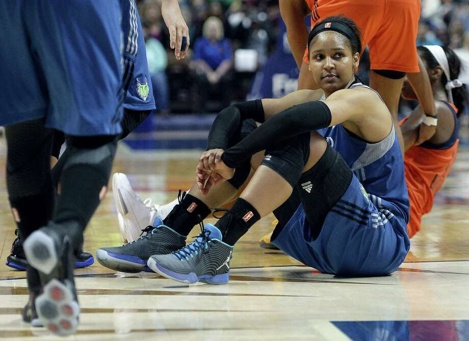 Maya Moore looks toward an official after being called for an offensive foul in overtime against the Connecticut Sun on Thursday in Uncasville. Photo: Jessica Hill — The Associated Press  / AP2016