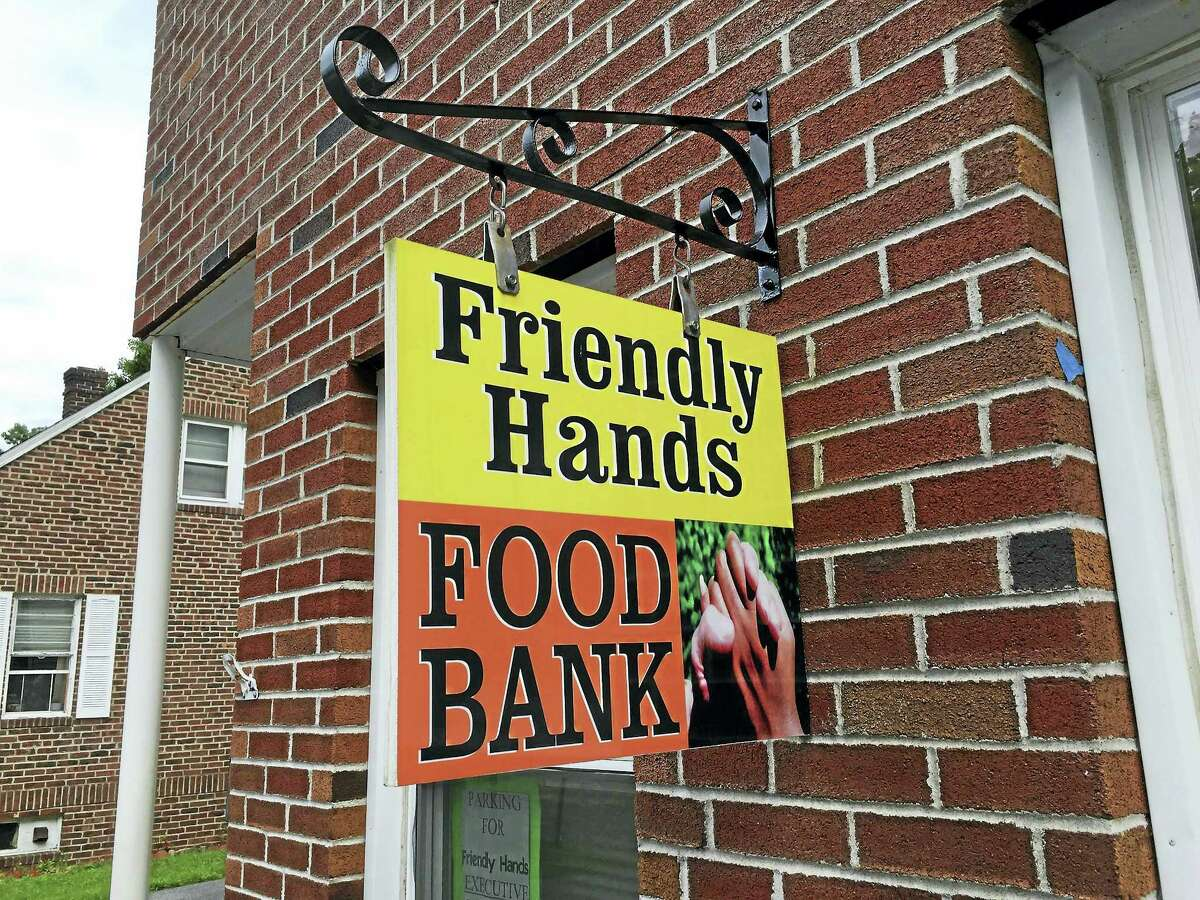 Maureen Hubert, executive director of Friendly Hands Food Bank in Torrington, says the facility may have to close because of a loss of state funding.