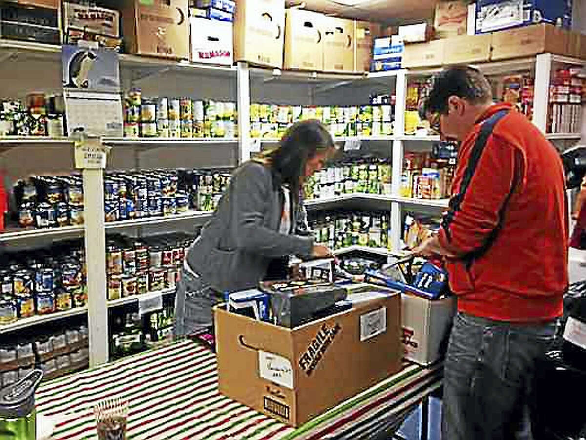 Volunteers sort toys during a holiday collection drive at Friendly Hands Food Bank in Torrington. The nonprofit organization serves needy families and individuals in greater Torrington.